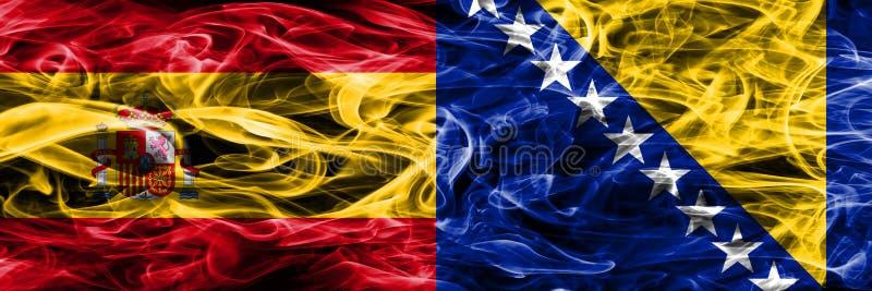 西班牙对波黑肩并肩被安置的烟旗子 库存图片