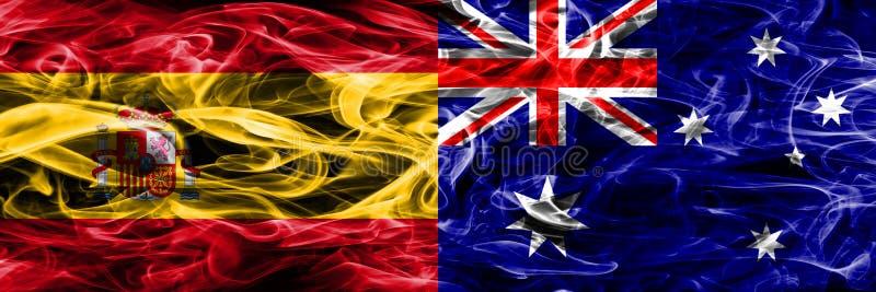 西班牙对澳大利亚肩并肩被安置的烟旗子 厚实的colore 图库摄影
