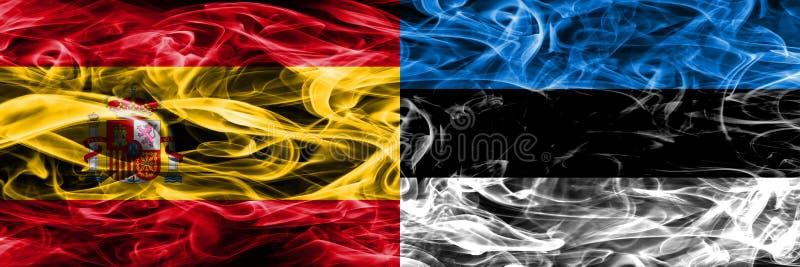 西班牙对爱沙尼亚肩并肩被安置的烟旗子 浓厚上色 免版税图库摄影