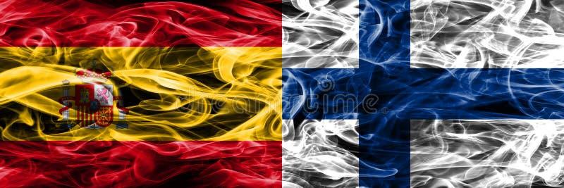 西班牙对芬兰肩并肩被安置的烟旗子 浓厚上色 图库摄影