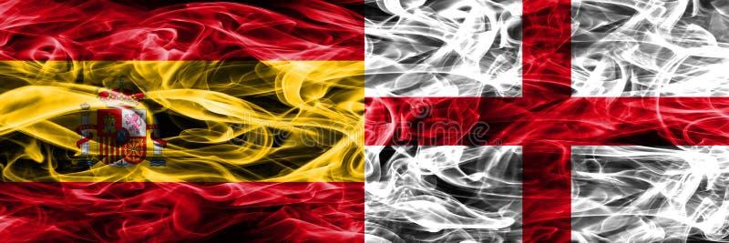 西班牙对英国肩并肩被安置的烟旗子 浓厚上色 库存图片