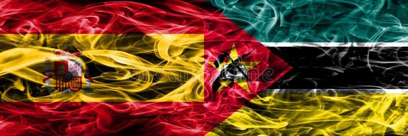 西班牙对莫桑比克肩并肩被安置的烟旗子 厚实的颜色 库存照片