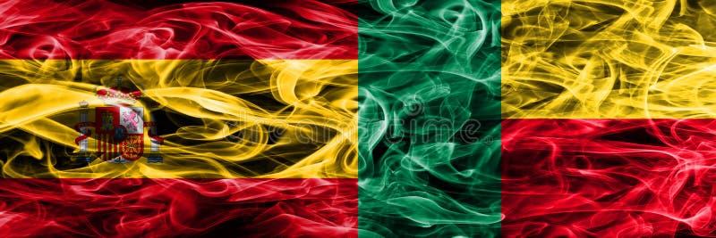 西班牙对贝宁肩并肩被安置的烟旗子 厚实的色的si 库存图片