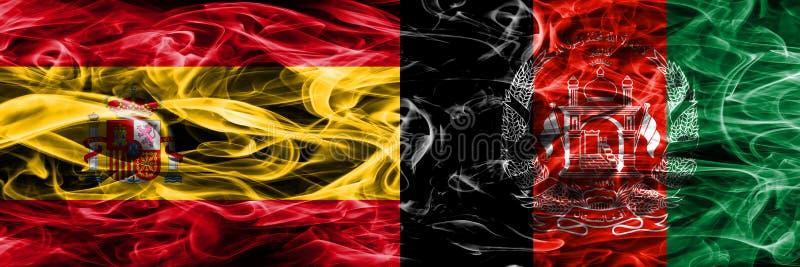 西班牙对阿富汗肩并肩被安置的烟旗子 厚实的colo 库存照片