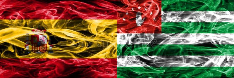 西班牙对阿布哈兹肩并肩被安置的烟旗子 浓厚上色 免版税库存图片