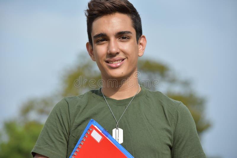 西班牙男性青少年的军事学生和微笑 免版税库存照片