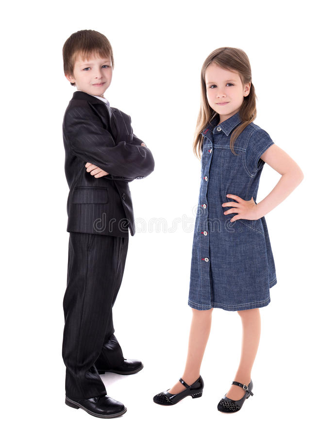 西装和女孩的小男孩在白色隔绝的礼服的 库存图片