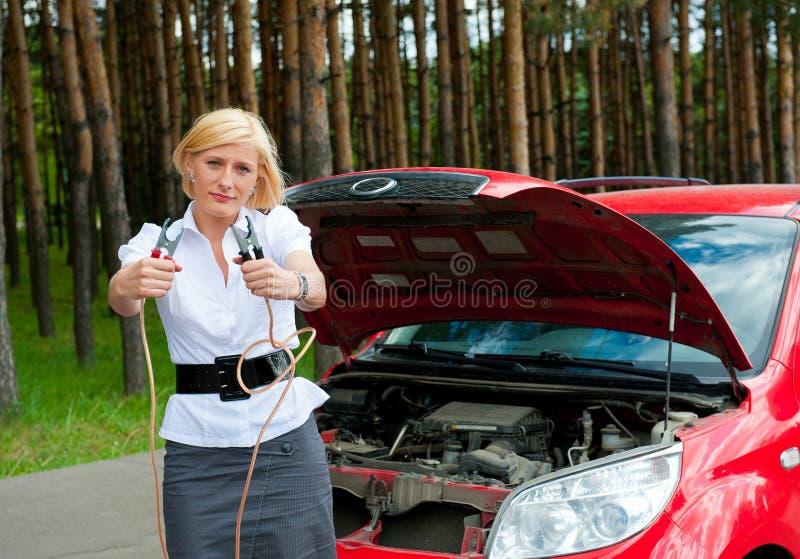 要求电池充电女孩帮助 库存图片