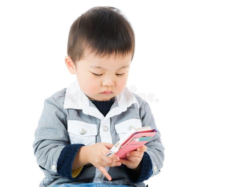 观看在机动性的小男孩 免版税库存照片