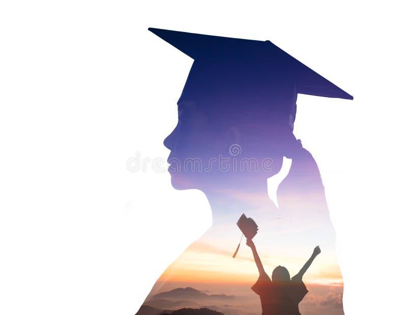 观看日出的学生毕业两次曝光 库存照片