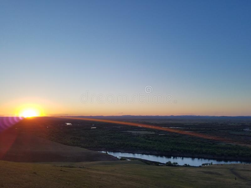 观看的日出在Hulun Buir草原 库存图片
