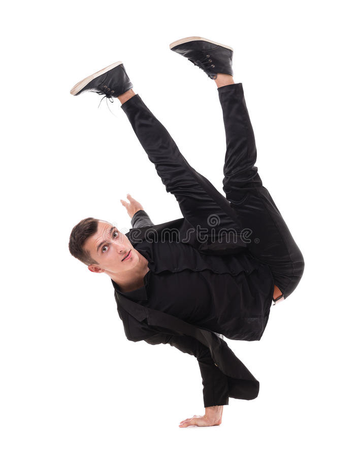解决一个适合的英俊的现代样式舞蹈家年轻的人,执行breakdance移动,在地板上的手立场 库存图片