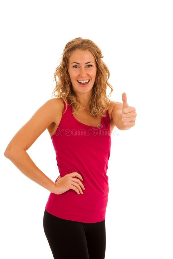 解决在健身健身房的逗人喜爱的年轻白肤金发的妇女被隔绝  库存照片
