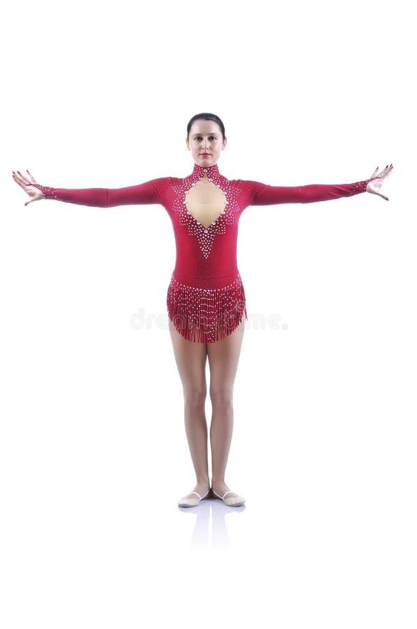 解决美丽的艺术性的女性的体操运动员,执行体操元素 免版税库存照片