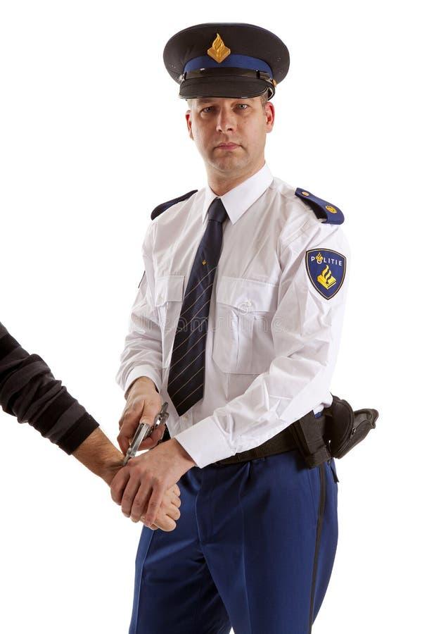 警察供以人员做拘捕 免版税库存图片