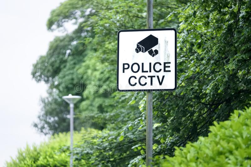 警察在岗位的CCTV标志 免版税库存照片