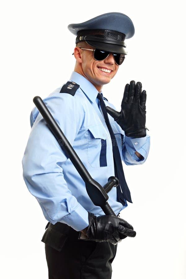 年轻警察招呼您 库存图片