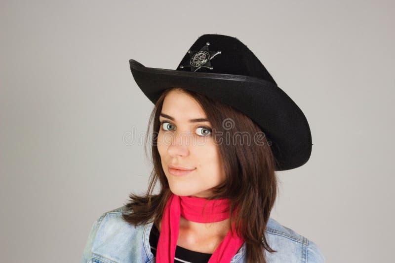 警长的帽子的女孩 库存照片