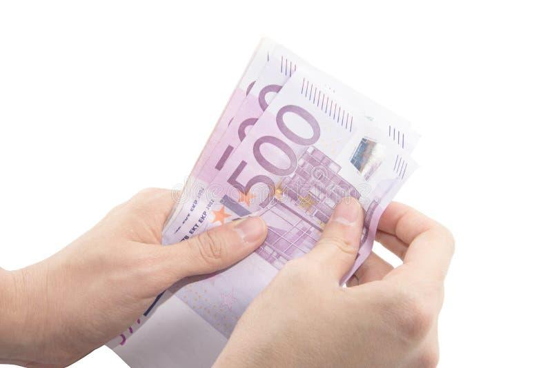 计数五百张欧洲钞票的被隔绝的手 图库摄影