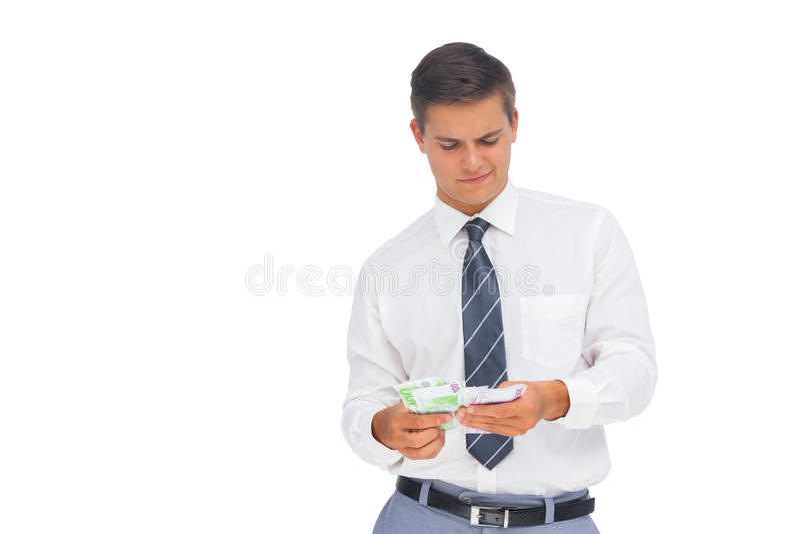 计数现金的商人 免版税库存照片