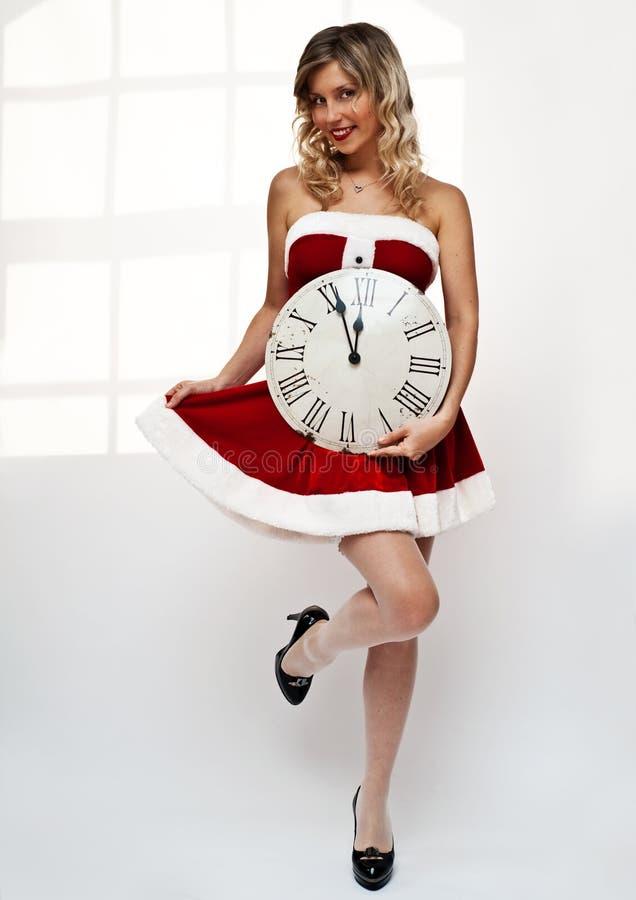 计时女孩圣诞老人墙壁 库存照片