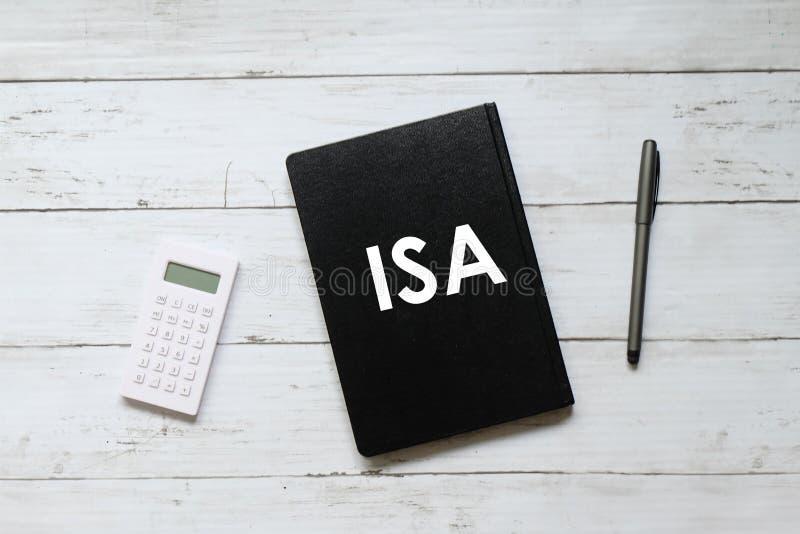 计算器、笔和笔记本顶视图写与ISA & x28; 单独挽救account& x29;在白色木背景 免版税库存图片