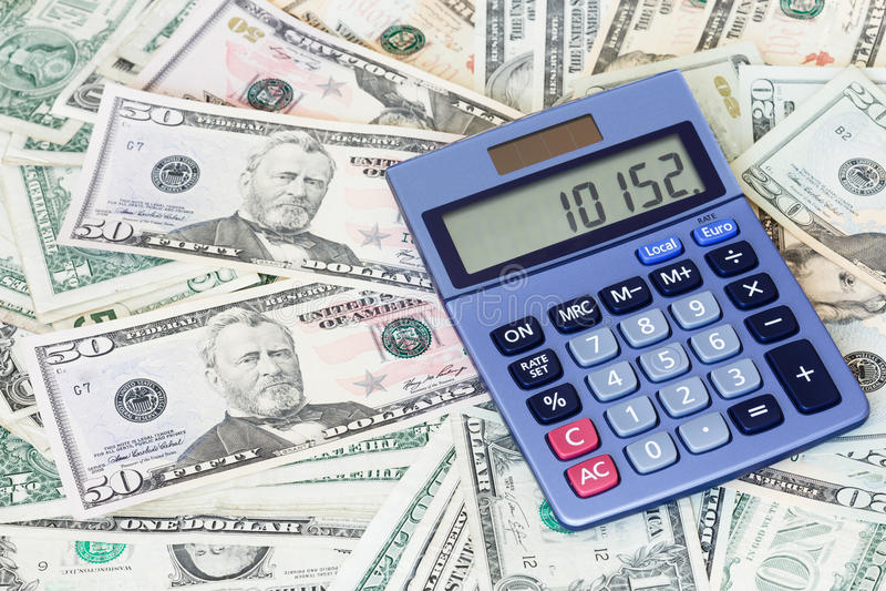 计算器和美元 免版税库存照片