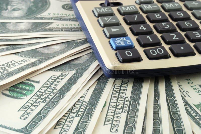 计算器美元堆 免版税库存图片