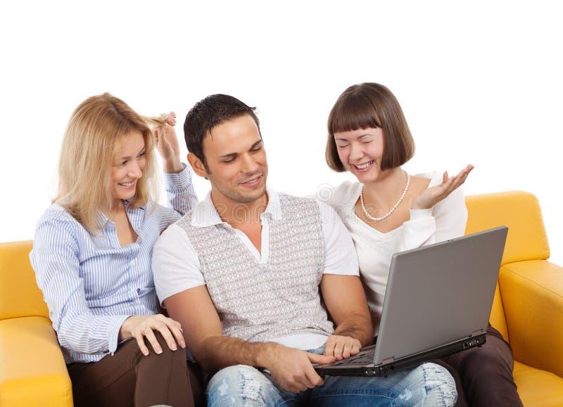 计算机愉快的膝上型计算机人年轻人 库存图片