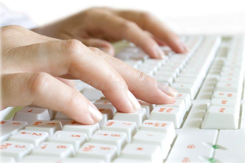 计算机手指关键董事会 库存图片