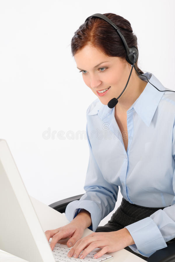 计算机服务台友好帮助键入的妇女 库存照片