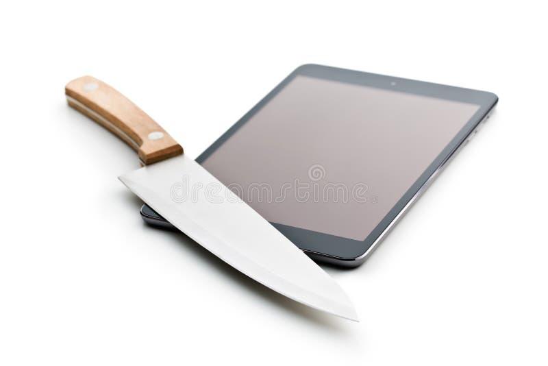 计算机片剂和刀子 库存图片