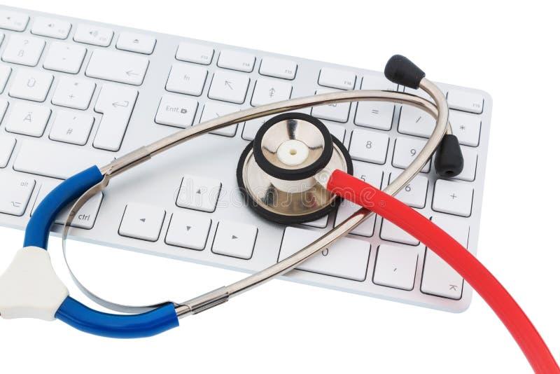 计算机的听诊器和键盘 免版税库存照片