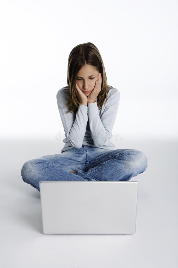 计算机表达式女孩相当震惊 免版税库存图片