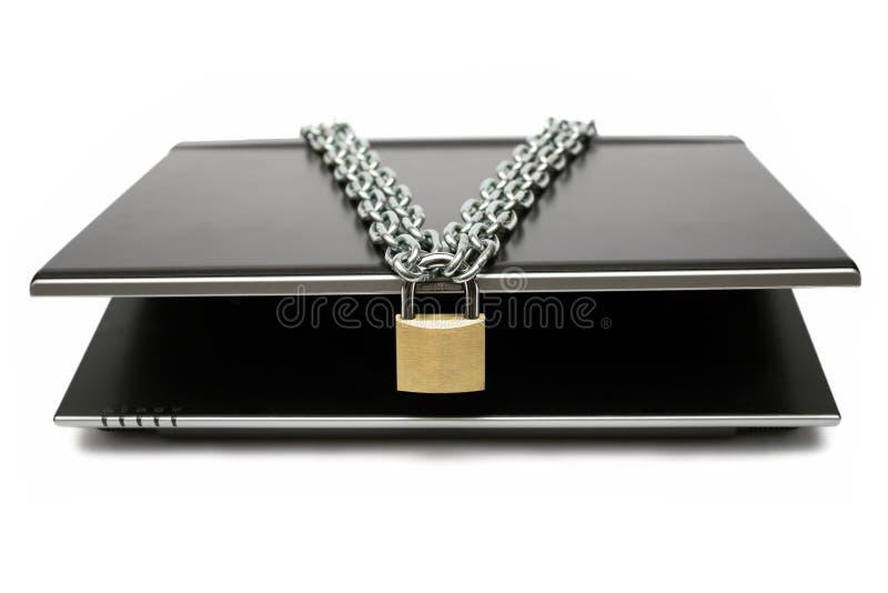 计算机锁着的移动电话 免版税库存照片