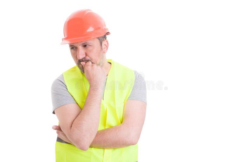 认为对计划的冥想的年轻建造者 免版税库存图片