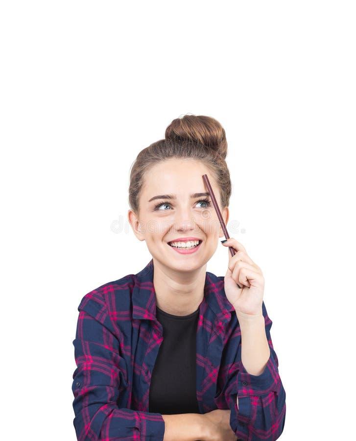 认为微笑的青少年的女孩,铅笔,被隔绝 免版税库存照片