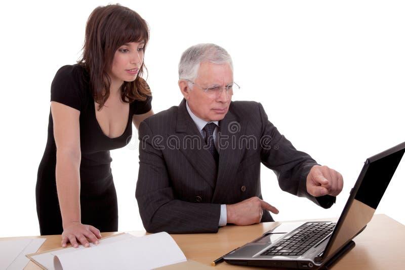 讨论的生意人妇女工作 库存照片
