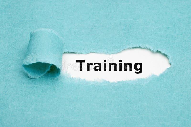 训练蓝色被撕毁的纸概念的词 库存图片