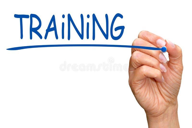 训练-有写蓝色文本的标志的女性手 库存图片
