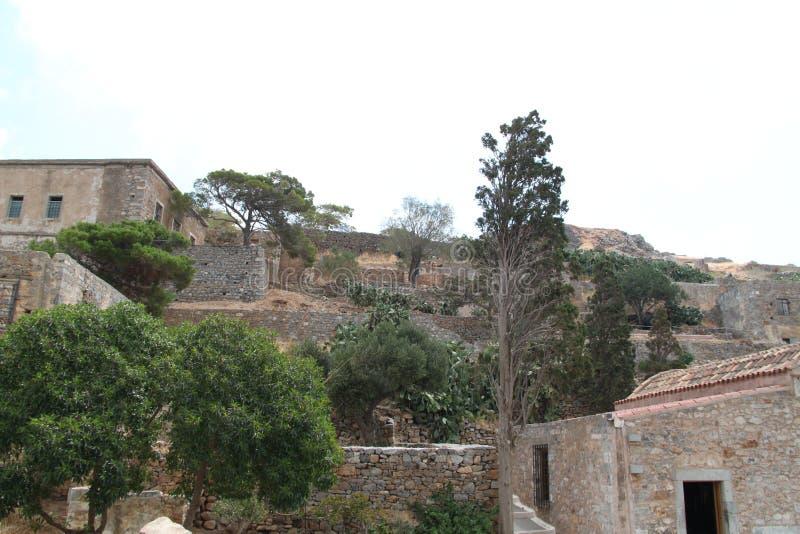 议院废墟,史宾纳隆加岛麻疯病患者殖民地堡垒, Elounda,克利特 免版税库存照片