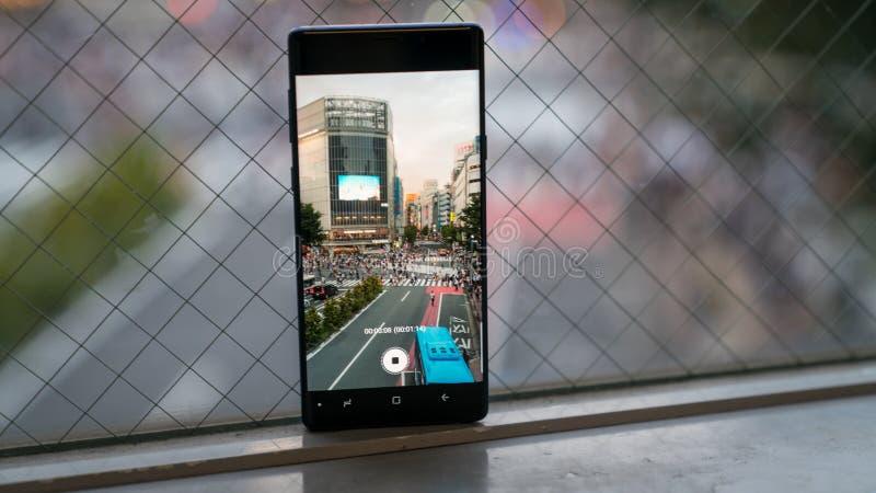 记录行人交叉路的录影智能手机涩谷横穿 免版税库存图片