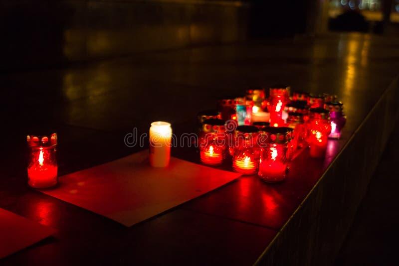记忆在红色的基督徒蜡烛 免版税库存图片