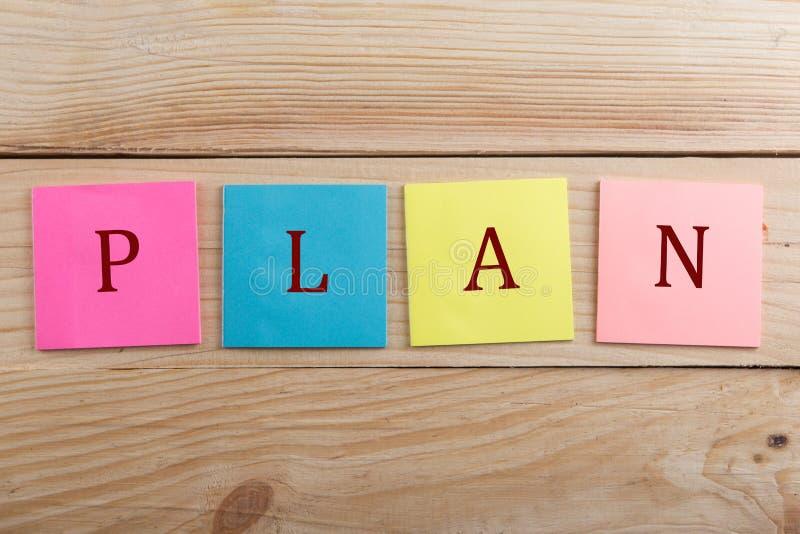 许多企业的概念-与文本计划的五颜六色的稠粘的笔记 库存图片