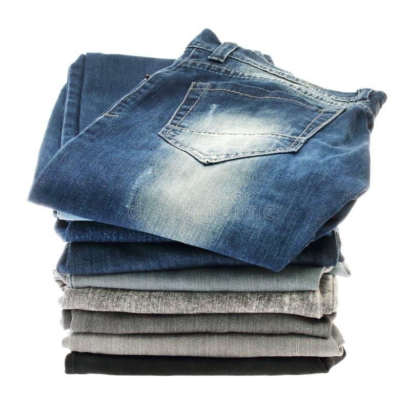 许多堆牛仔裤 库存照片