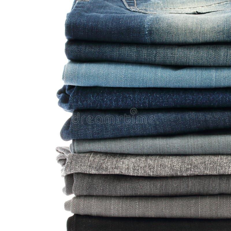 许多堆牛仔裤 免版税库存照片
