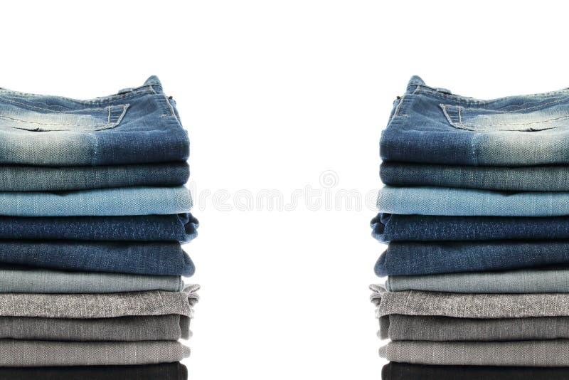 许多堆牛仔裤 免版税库存图片