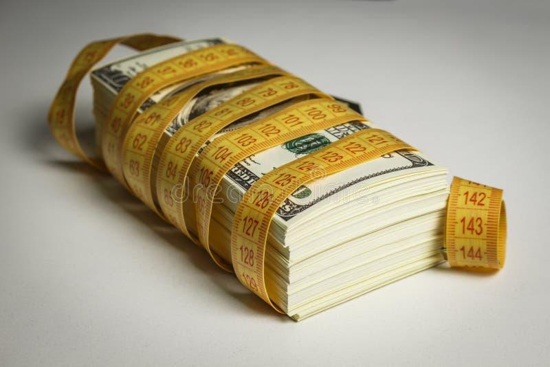 许多美金栓与米 库存图片