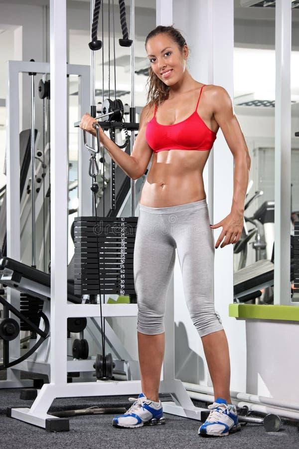设备健身妇女工作 免版税库存图片