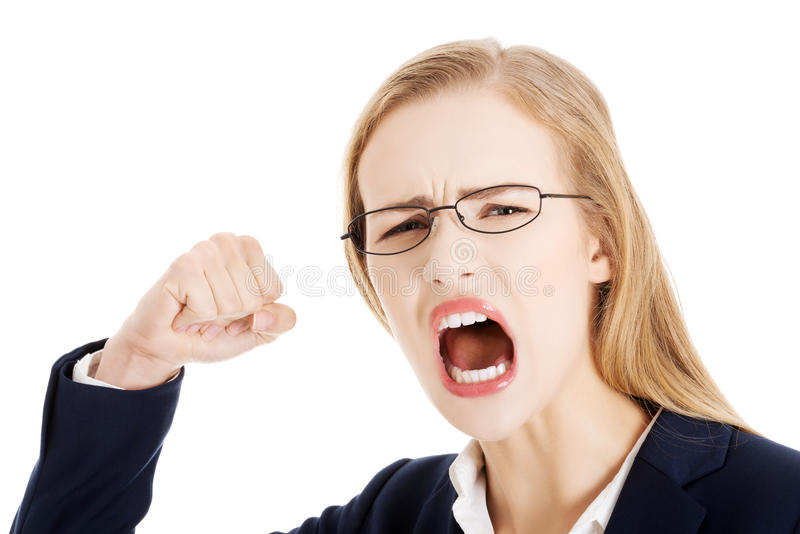 设法愤怒的恼怒的女商人猛击您。 图库摄影